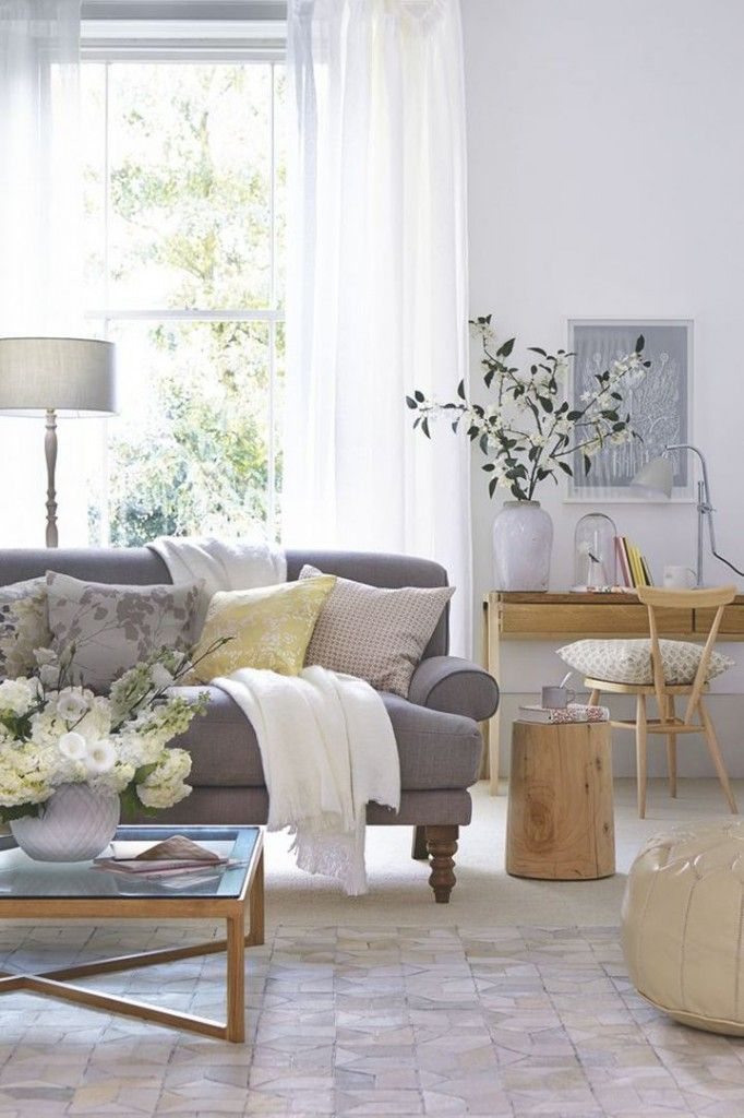 Sheer drapes feel light and airy. Image via mariakillam.com